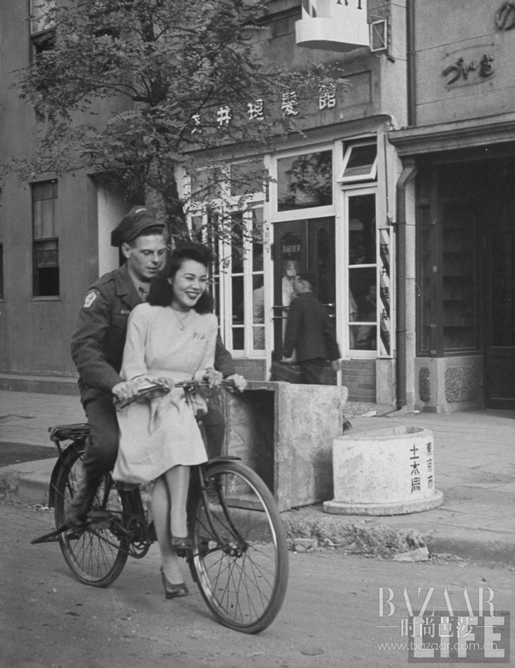 US Soldier Giving Japanese Girl A Bicycle Ride, With Handlebar Riding Forbidden, 1946, Japan